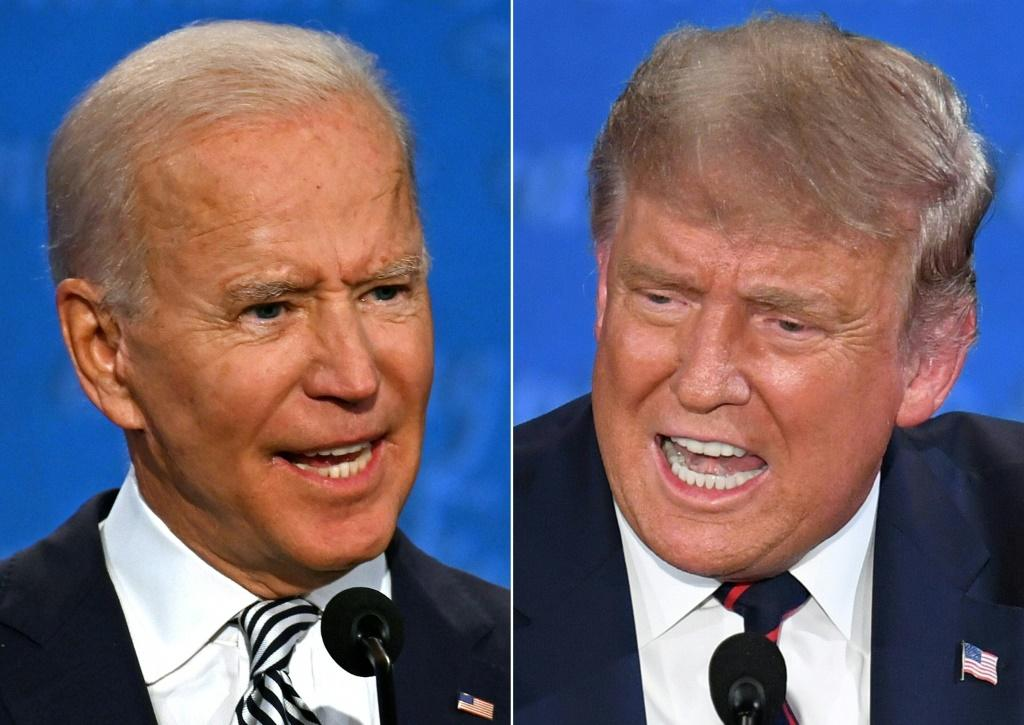 """US President Donald Trump (right) accused the bipartisan debate commission of trying to """"protect"""" his opponent Joe Biden"""