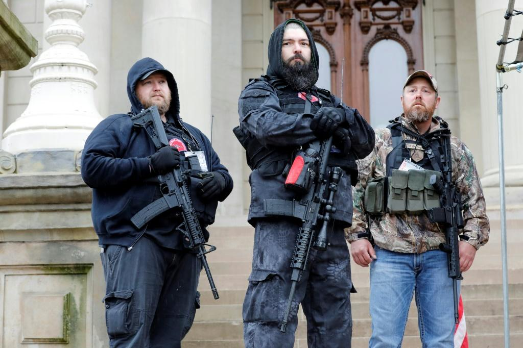 Michael Null (L), one of those arrested in the plot to kidnap Michigan Governor Gretchen Whitmer, at an April 2020 rally against Covid-19 restrictions