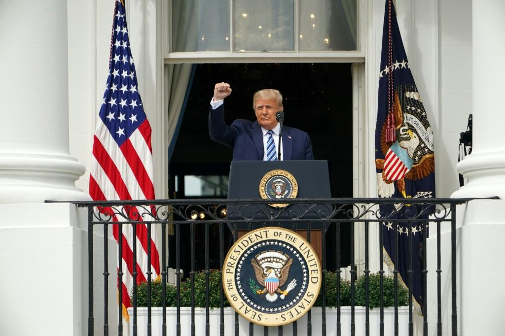 US President Donald Trump hosted hundreds of supporters at the White House for his first public event since contracting Covid-19