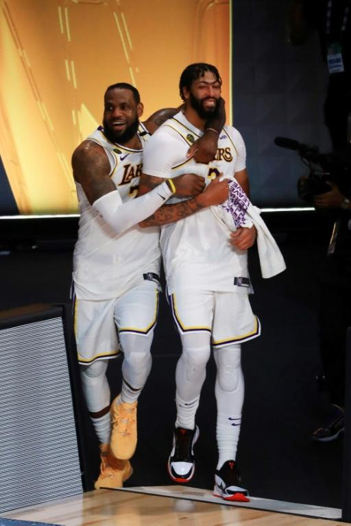 LeBron James and Anthony Davis celebrate the Los Angeles Lakers' title-clinching victory over the Miami Heat in game six of the NBA Finals