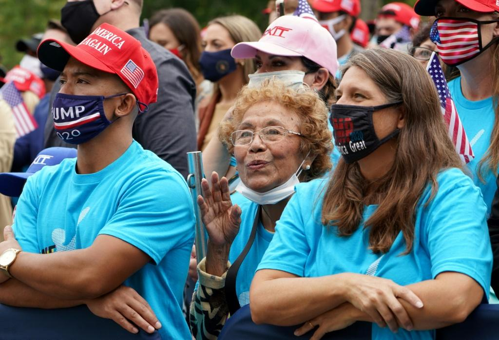 Supporters listen to President Donald Trump on October 10, 2020, making his first public appearance at the White House since contracting Covid-19