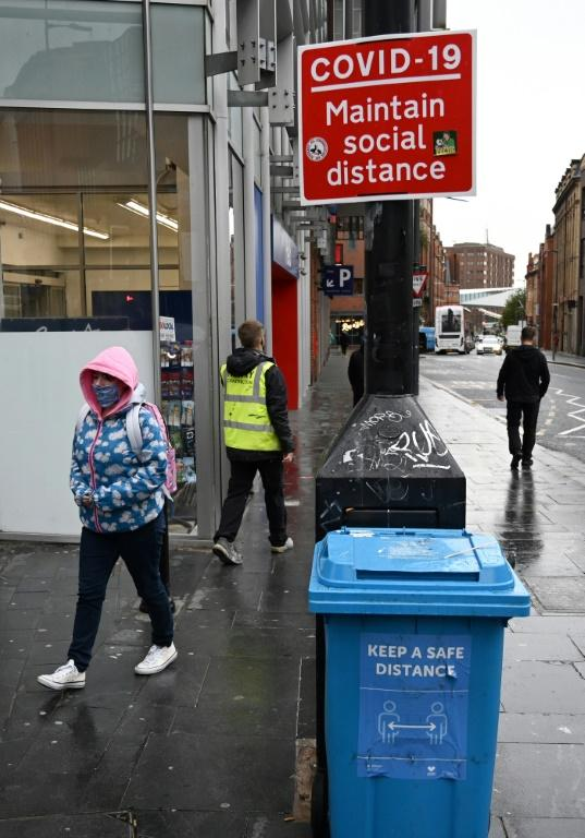 "A street sign advises members of the public to ""Maintain Social Distance"" in Liverpool"