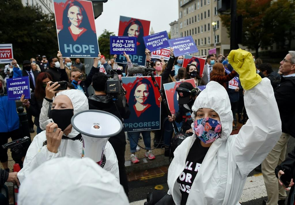 Dueling rallies in support of and against Supreme Court nominee Amy Coney Barrett were held on Capitol Hill on the first day of her confirmation hearings