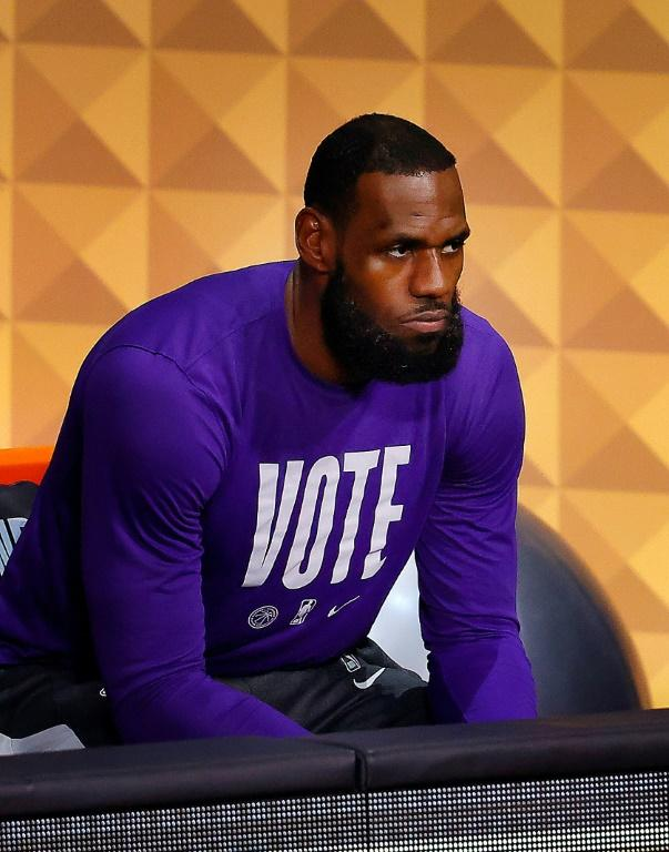 LeBron James of the Los Angeles Lakers wears a VOTE shirt during a pre-game warm-up period in the NBA Finals