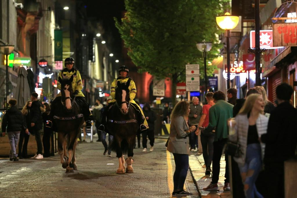 Police patrolled on horseback in Liverpool Saturday as people stayed out late partying