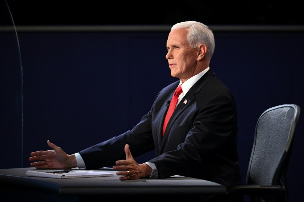 "US Vice President Mike Pence, pictured during the vice presidential debate on October 7, 2020, in Salt Lake City, Utah, said he hopes Amy Coney Barrett ""gets a fair hearing"