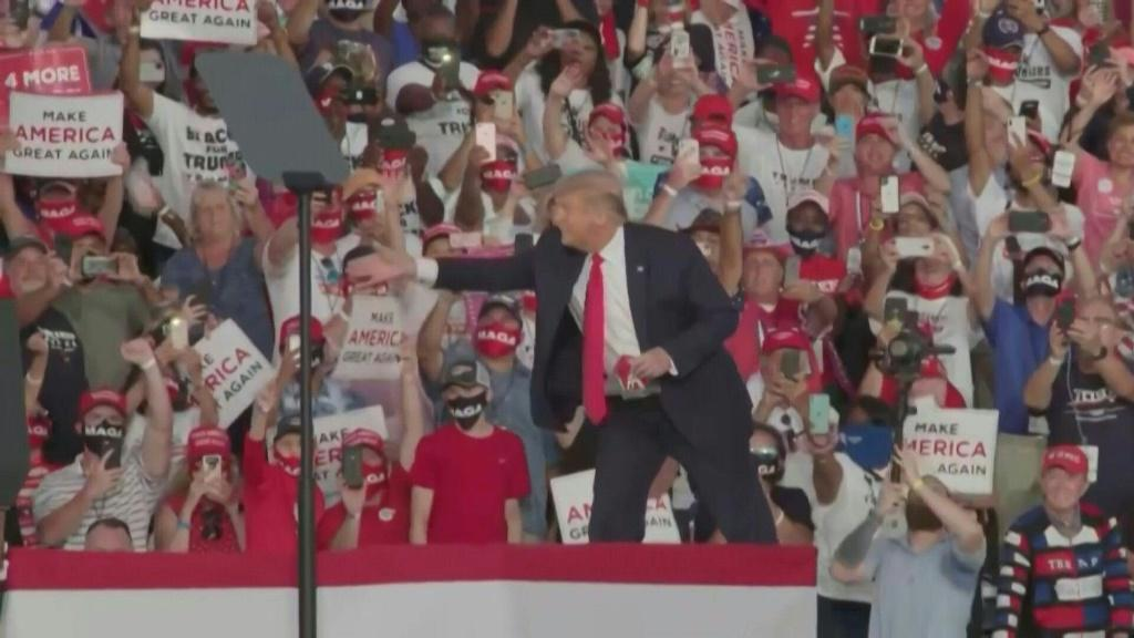 IMAGESIn his first campaign rally since contracting Covid-19, US President Donald Trump takes the stage in Sanford, Florida, himself maskless, and throws red masks out into the audience instead of the usual Make America Great Again baseball caps. Trump ha