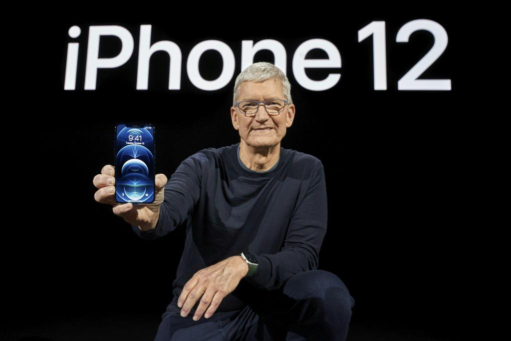 In this photo released by Apple, Apple CEO Tim Cook holds up the all-new iPhone 12 Pro during an Apple event at Apple Park in Cupertino, California on October 13, 2020