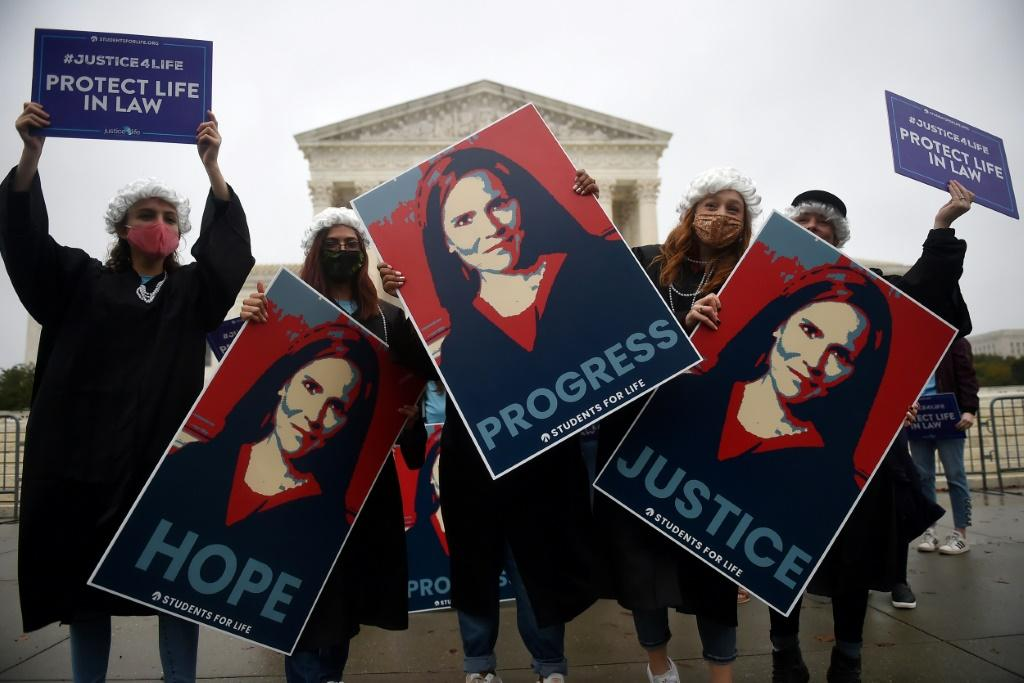 Supporters of President Donald Trump's Supreme Court nominee, Amy Coney Barrett outside the court