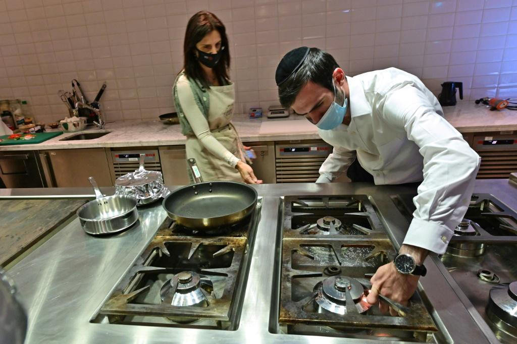 Rabbi Yaakov Eisenstein (R) supervises the preparation of food atElli's Kosher Kitchen, set up two years ago to enable Jewish travellers to remain observant while visiting the UAE