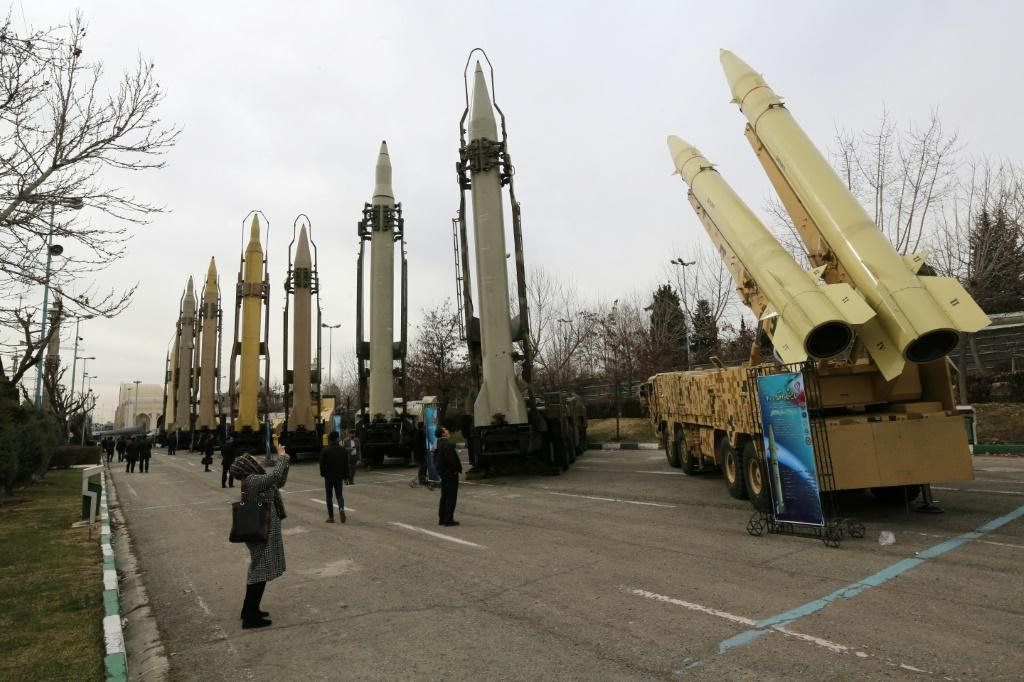 A file photo taken on February 2, 2019, shows Iranians visiting a weaponry and military equipment exhibition in the capital Tehran