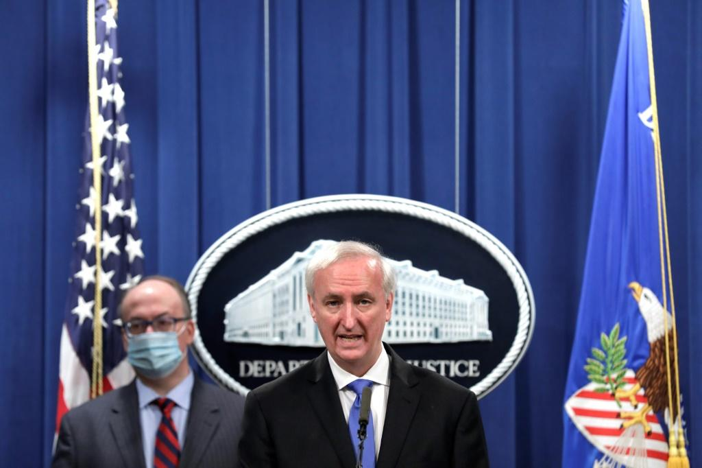 Deputy US Attorney General Jeffrey Rosen(C) announces that Purdue Pharma has agreed to plead guilty to criminal charges over its sales of the addictive prescription opioid OxyContin, which fed a national addiction epidemic