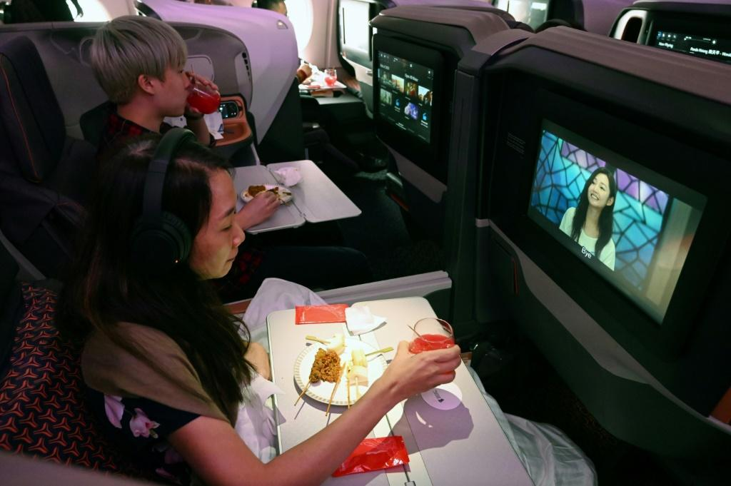 Diners watch movies while dining in business class