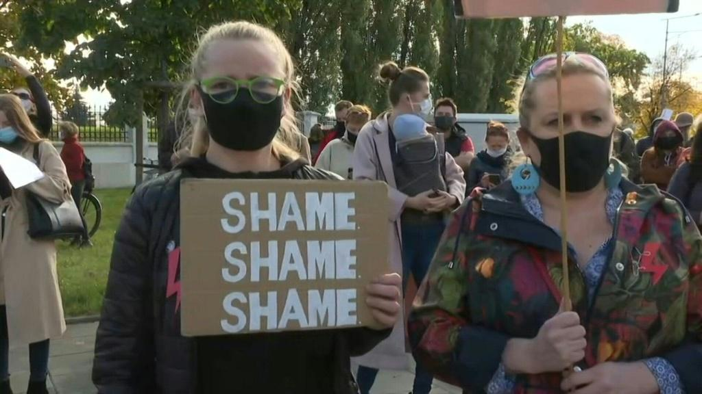 IMAGES Protesters denouncing a near-total ban on abortion gather at the Warsaw headquarters of the governing right-wing Law and Justice (PiS) party.