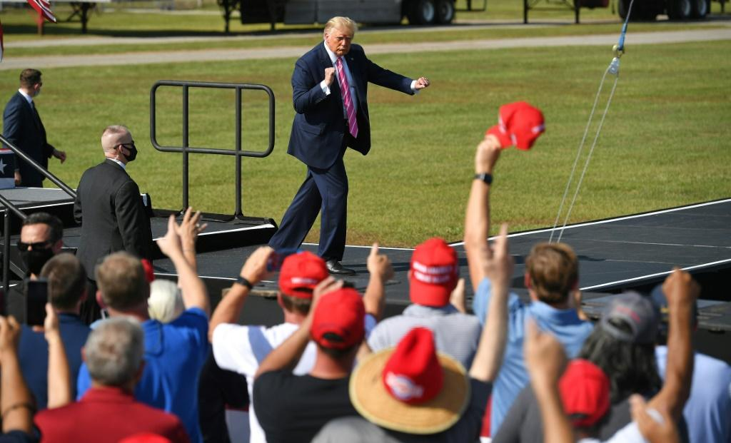 US President Donald Trump dances at the end of a campaign rally in North Carolina on October 24