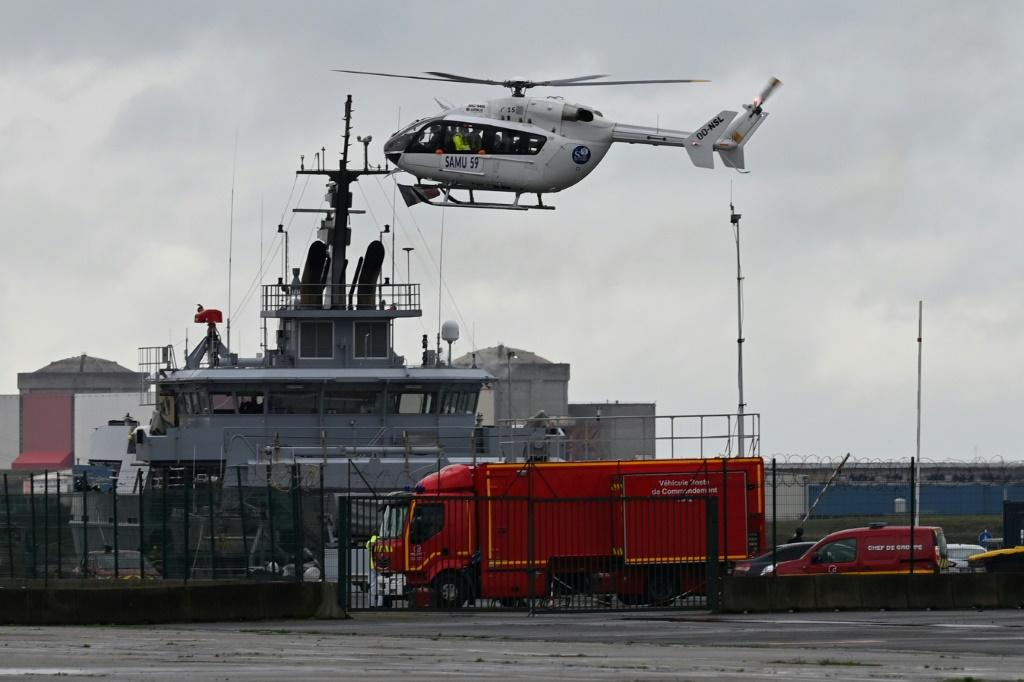 A SAMU (French Urgent Medical Aid Service) helicopter lands at Dunkirk port, northern France after a small boat carrying migrants sank and a man was found dead