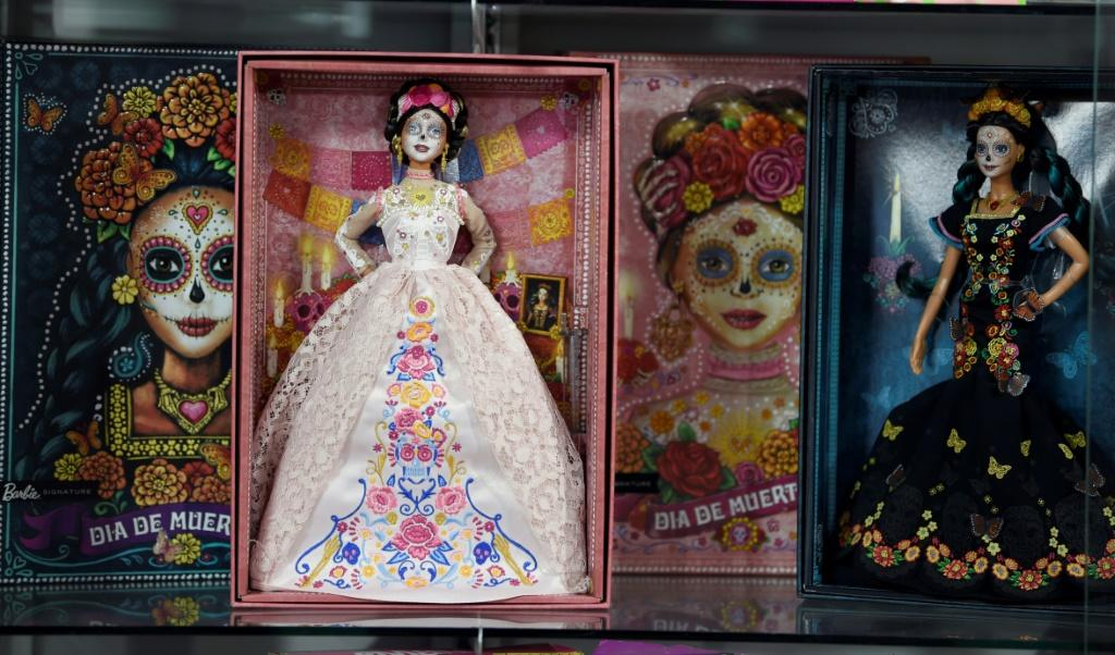 """This year """"Catrina"""" Barbie wears a blush-colored lace dress, unlike last year when she was dressed in black"""