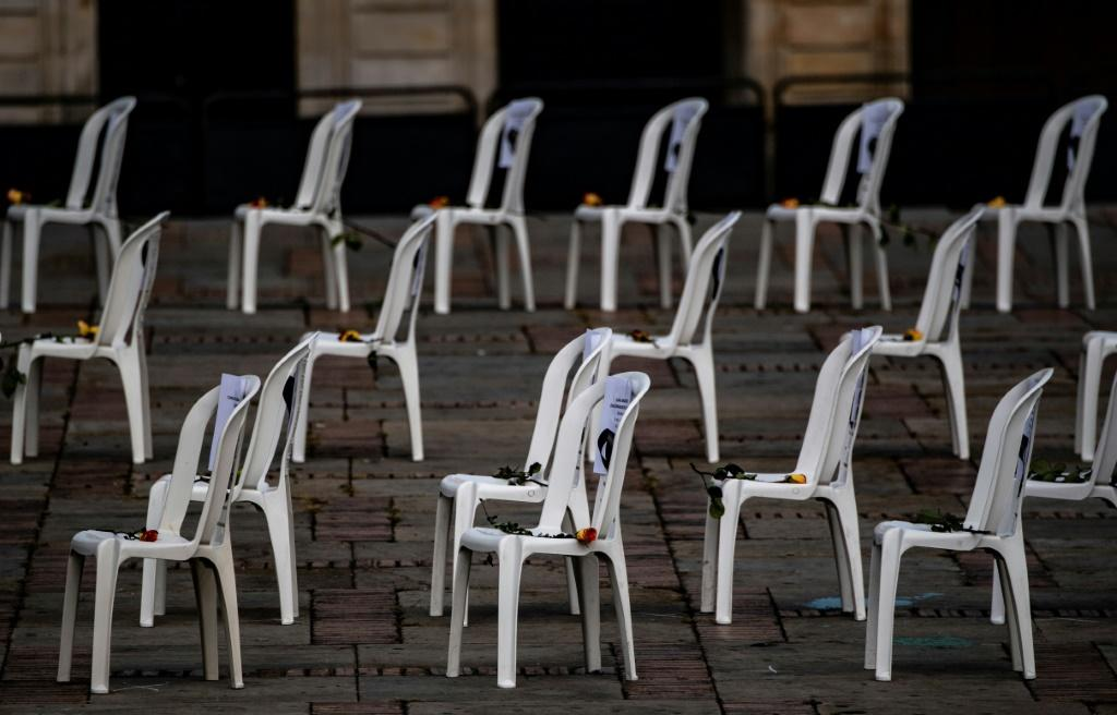Chairs bearing the names of health workers who died from Covid-19 are set up during a protest against he Colombian health system