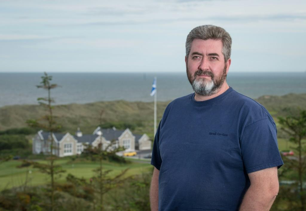 David Milne, seen on a hillside above the clubhouse of Donald Trump's International Golf Links course on Scotland's east coast, is aghast that the local council has given the go-ahead for a second course