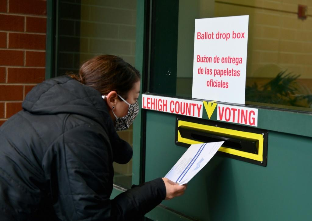 Americans, such as this voter in Pennsylvania, have been casting their ballots in record numbers ahead of the November 3, 2020 election