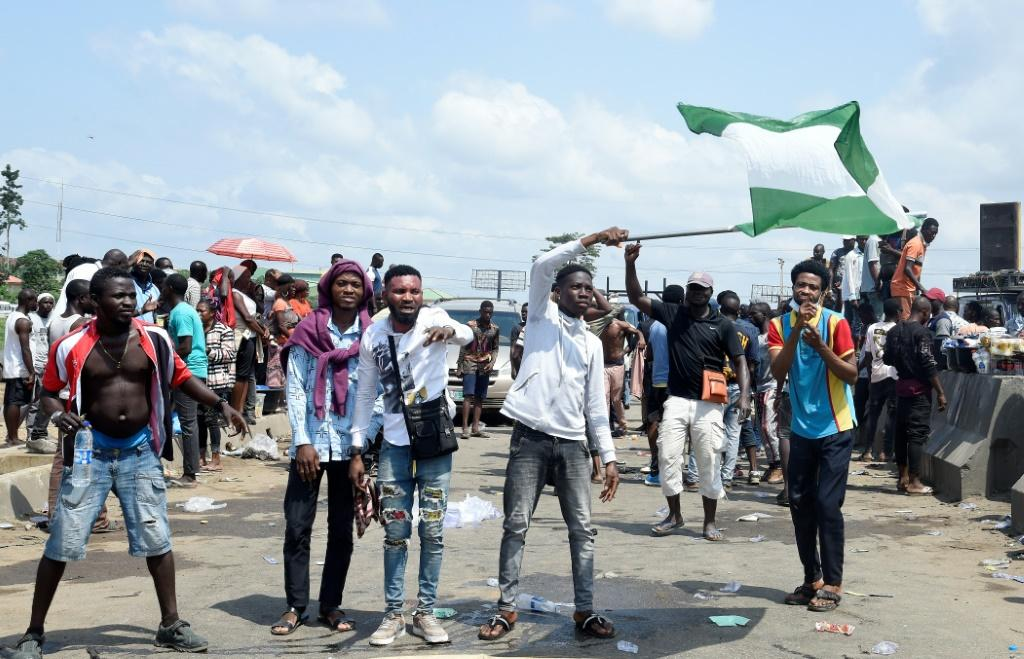 Demonstrations began on October 8, targeting a hated police unit, the Special Anti-Robbery Squad (SARS)