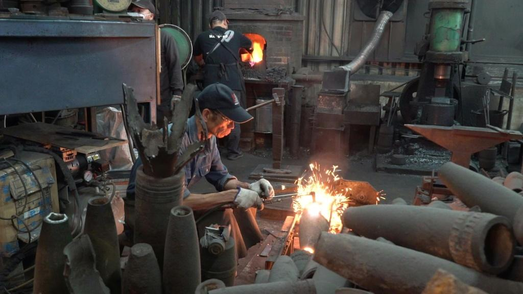 """In a contemporary twist on beating swords into ploughshares, Taiwanese blacksmith Wu Tseng-dong has forged a career converting Chinese artillery shells once fired in anger into kitchen knives. Known locally as """"Maestro Wu"""", his workshop on the island of K"""