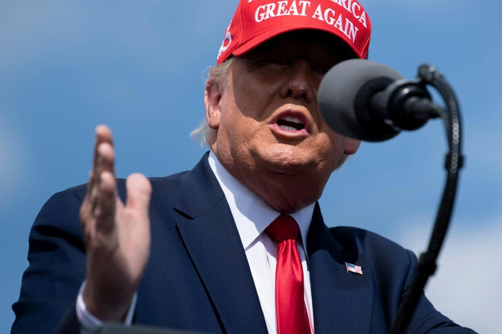 President Donald Trump -- pictured at a rally in Tampa, Florida -- has stuck to his strategy of downplaying the danger of the coronavirus and calling for businesses to reopen