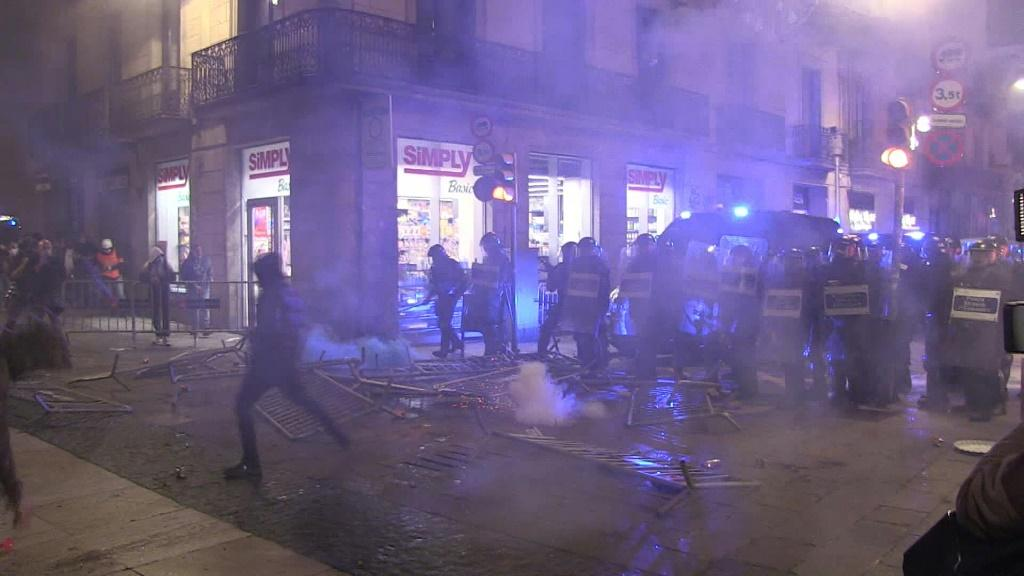 Police and demonstrators clash in Barcelona at a protest over virus restrictions