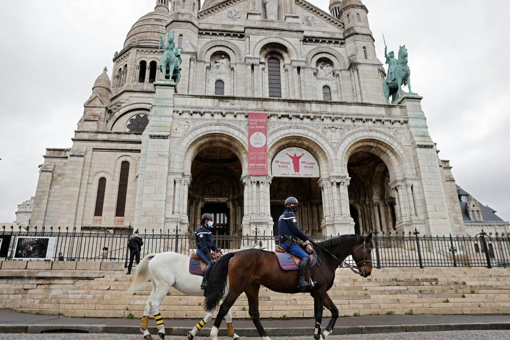 French mounted police patrolled in front of the Sacre-Coeur basilica during an All Saints' Day mass in Paris.