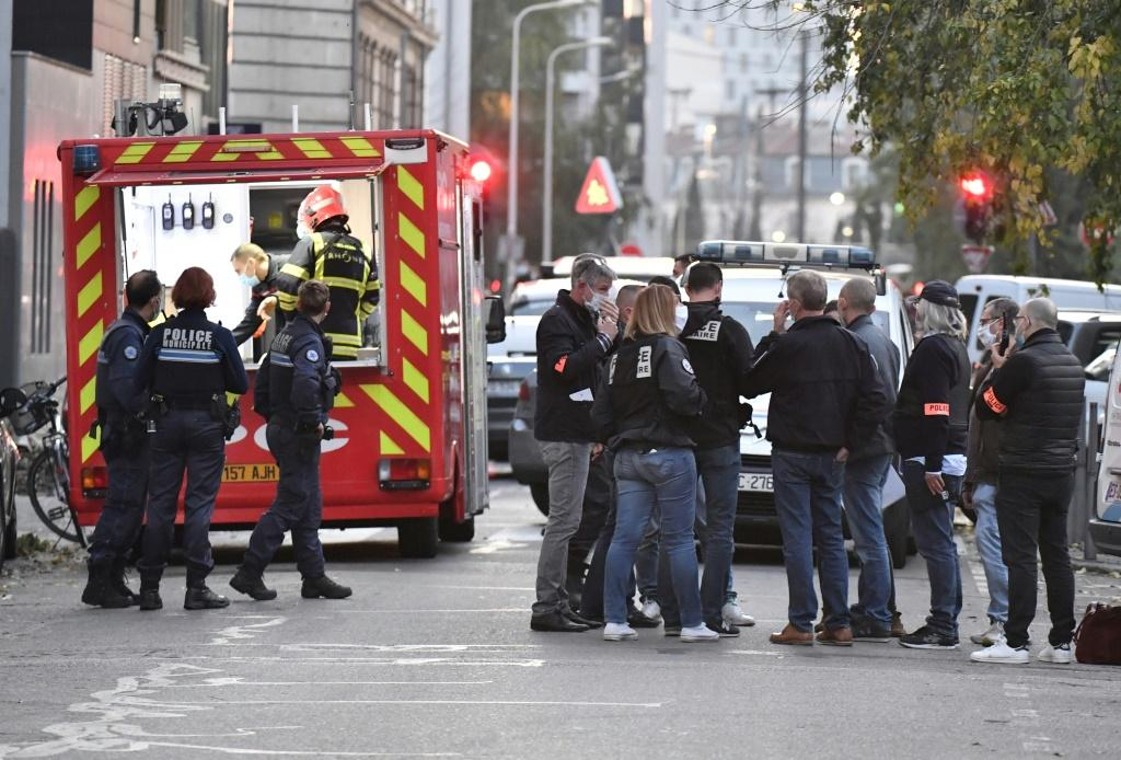 Security and emergency personnel on the scene of an attack targeting a Greek Orthodox priest in Lyon on Saturday.