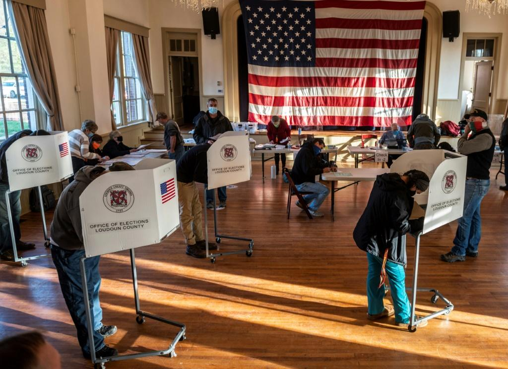 Voters cast their ballots in Hillsboro, Virginia on Election Day, with President Donald Trump seeking to defy polls and win a second term