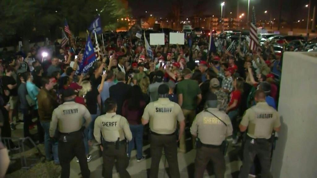 Pro-Trump protesters gather outside an Arizona vote-counting center