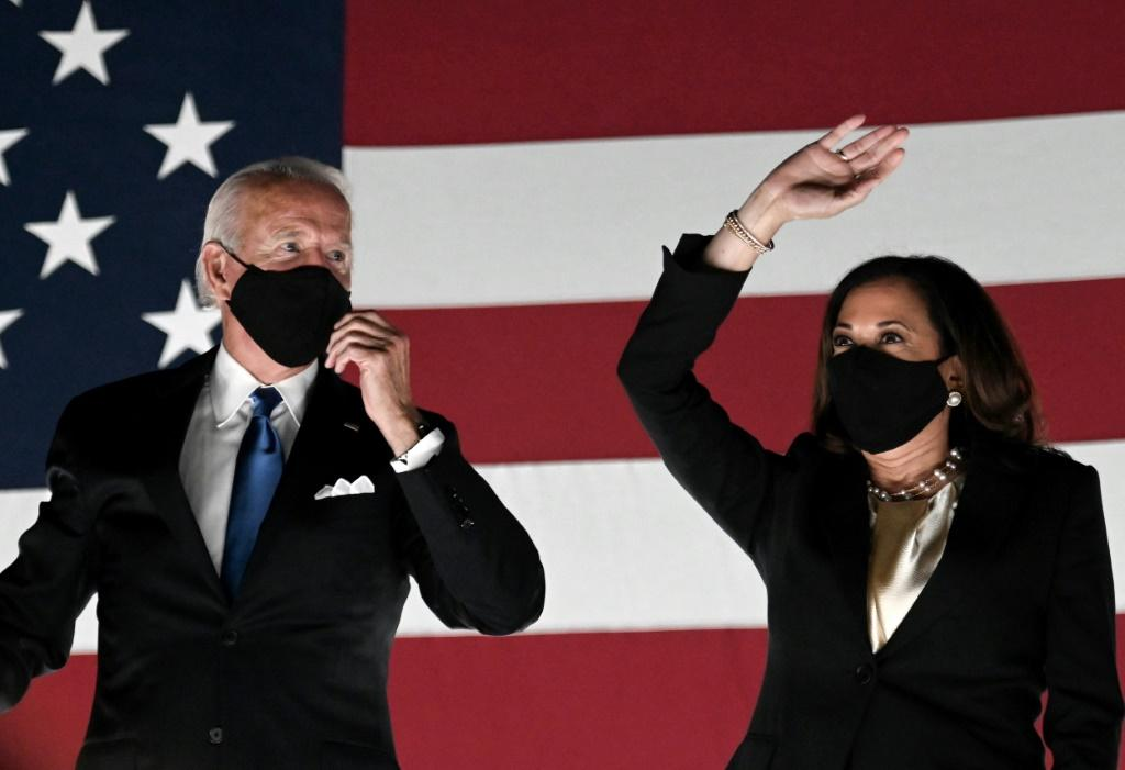 Former vice-president and Democratic presidential nominee Joe Biden (L) and Senator from California and Democratic vice presidential nominee Kamala Harris greet supporters outside the Chase Center in Wilmington, Delaware, at the conclusion of the Democrat
