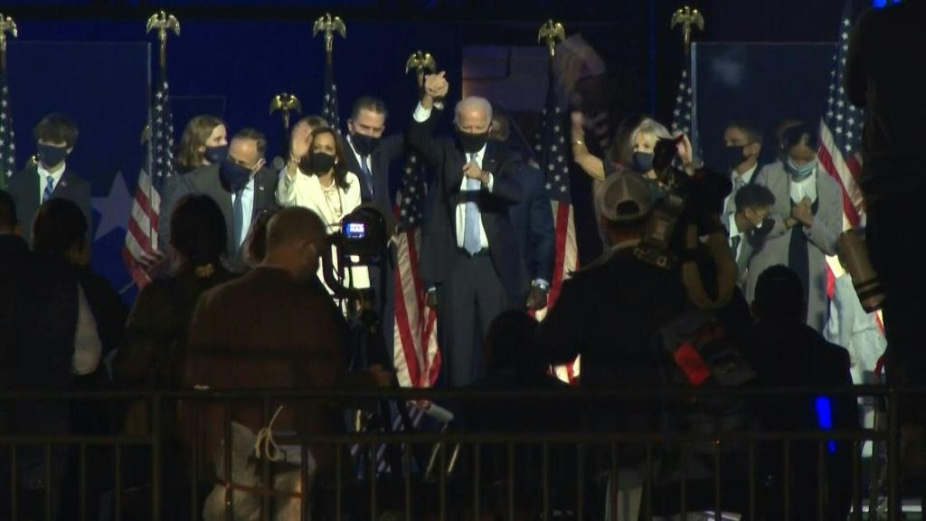 US President-elect Joe Biden and US Vice President-elect Kamala Harris give a victory speech followed by fireworks, in front of hundreds of supporters at a drive-in rally held outside the Chase Center in Wilmington, Biden's hometown in the state of Delawa