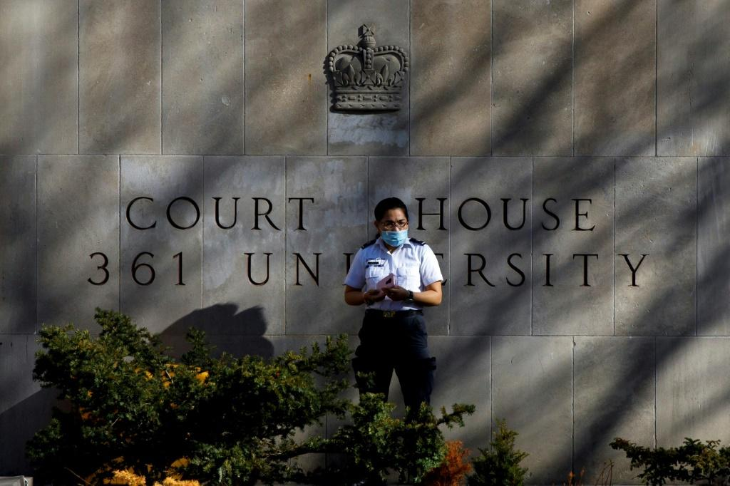 A security guard stands outside the Superior Court of Justice in Toronto during the first day of Alek Minassian's trial