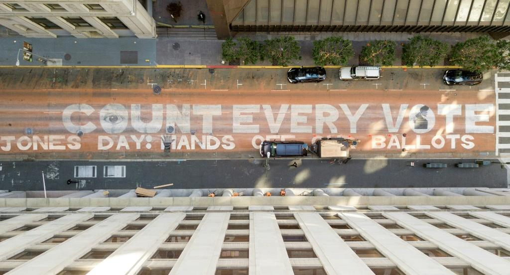 "An aerial view of the slogan ""Count Every Vote. Jones Day: Hands off our ballots"" is seen on November 10, 2020 on a San Francisco street"