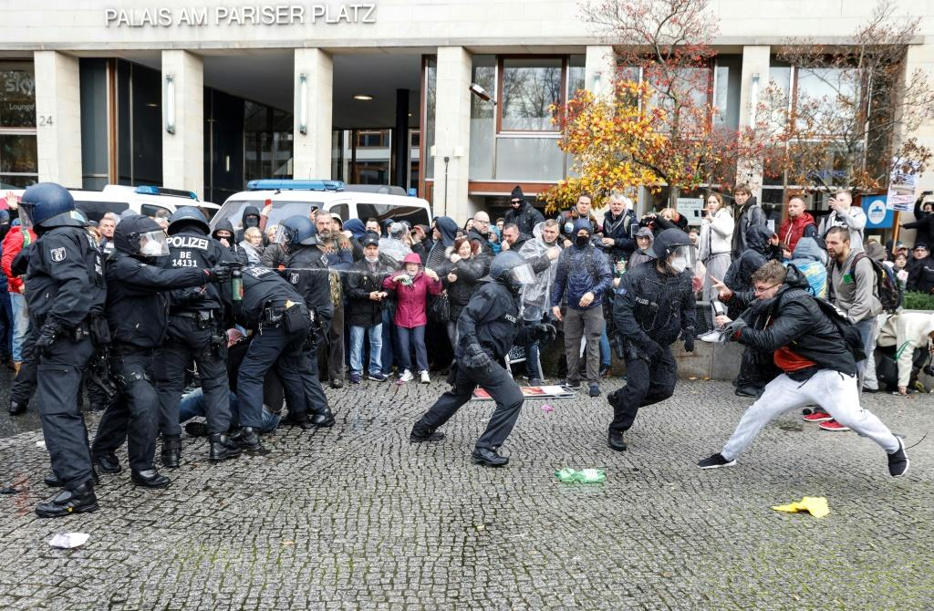 Police in Berlin fired water cannon on Wednesday to disperse thousands of unmasked protesters.