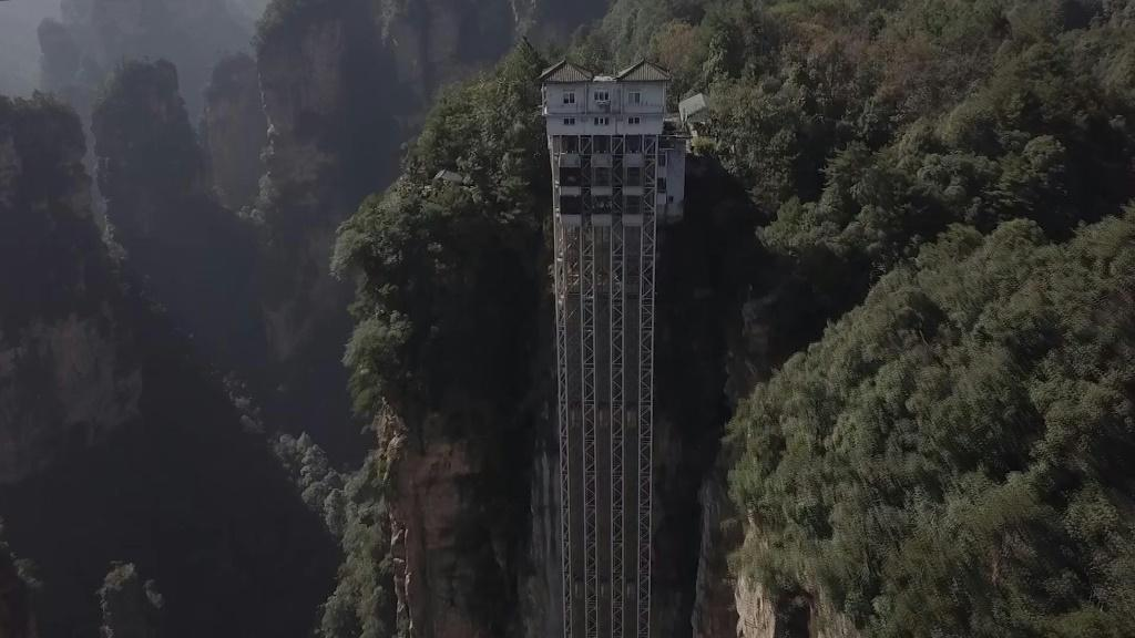 "Towering 326 metres up the cliff face which inspired the landscape for the blockbuster movie ""Avatar"", races the world's highest outdoor elevator, whisking brave Chinese tourists to breathtaking views. The three double-decker elevators in central China'"