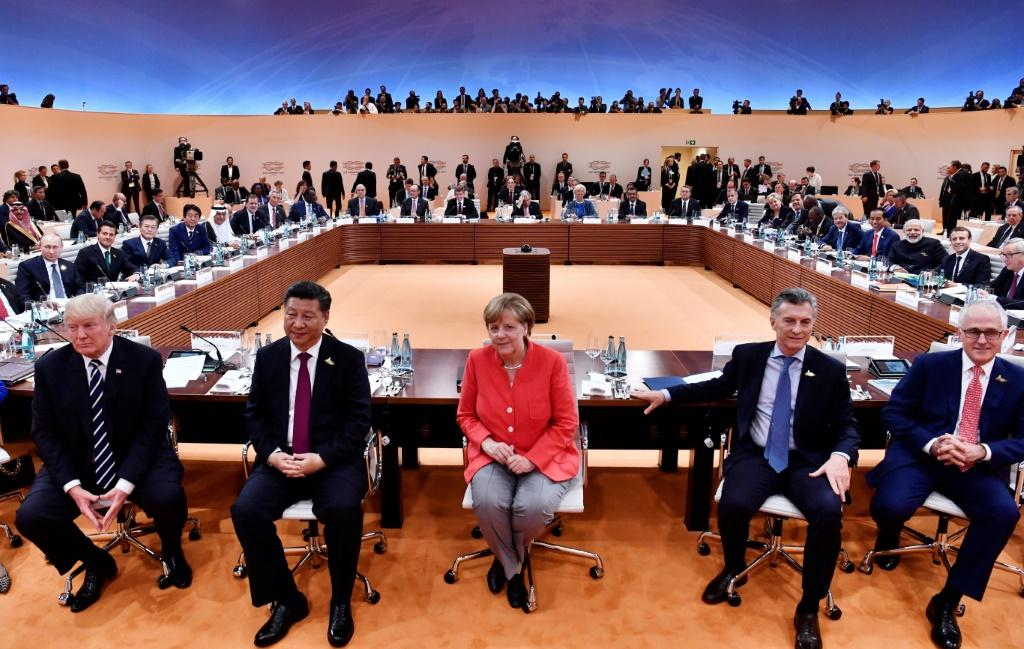 Many liberals around the world may still hail the brainy, pragmatic and unflappable Merkel as a welcome counter-balance to the big, brash men of global politics