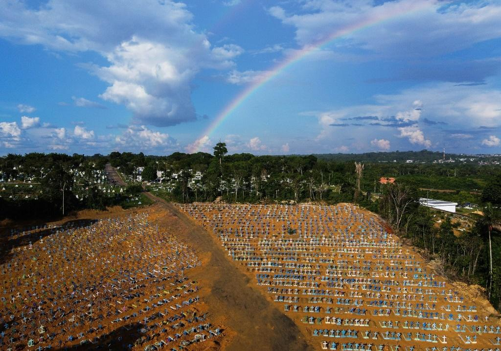 Aerial view of the burial site reserved for victims of the Covid pandemic with a rainbow in the sky at the Nossa Senhora Aparecida cemetery in Manaus, in the Amazon forest in Brazil