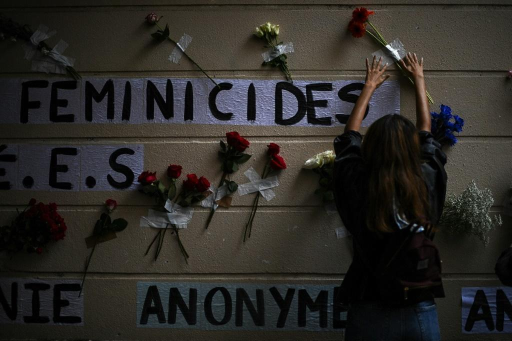Activists in France have posted the names of women killed by men on buildings across Paris