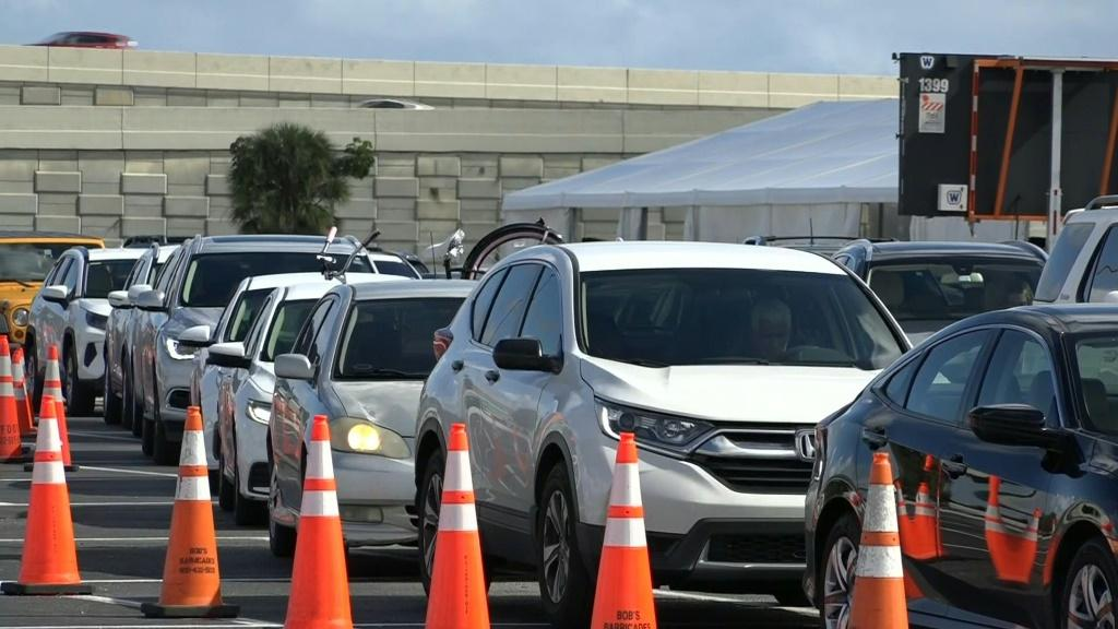 IMAGESCars line up at a drive-through Covid-19 testing site in Miami, Florida as cases of the coronavirus continue to surge ahead of the Thanksgiving holiday.