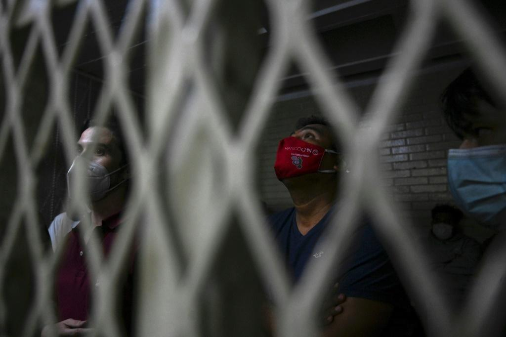 People who were detained during a protest demanding the resignation of Guatemalan President Alejandro Giammattei, pictured in a cell in Guatemala City, November 2020