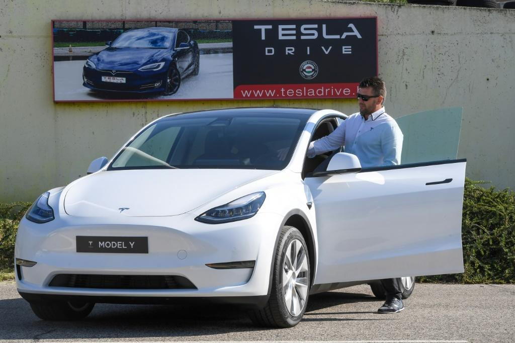 A driver prepares to test drive a Tesla on September 5, 2020, during a presentation at the Automobile Club of Budapest