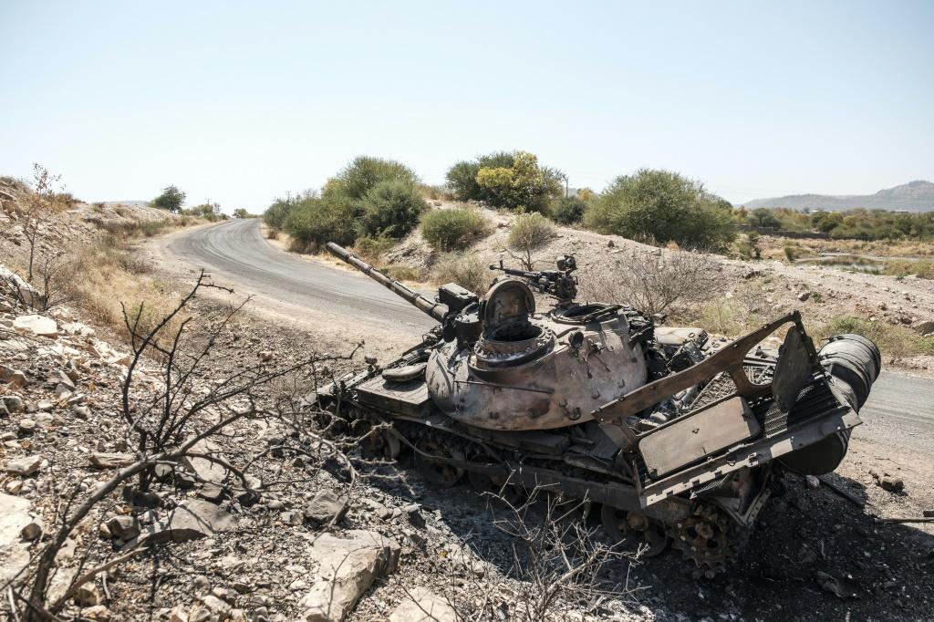 A damaged tank stands abandoned on a road near the Tigrayan city of Humera