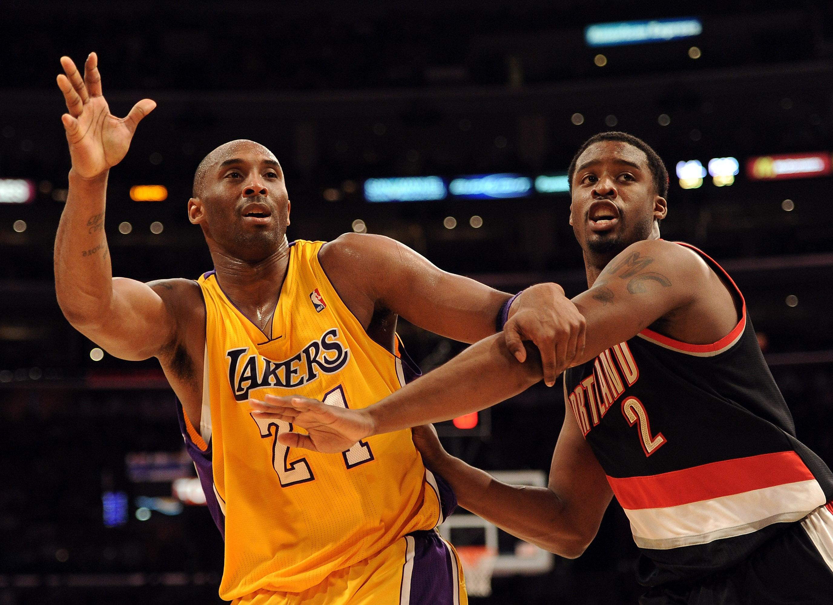 Kobe Bryant #24 of the Los Angeles Lakers calls for an inbound pass in front of Wesley Matthews #2 of the Portland Trail Blazers