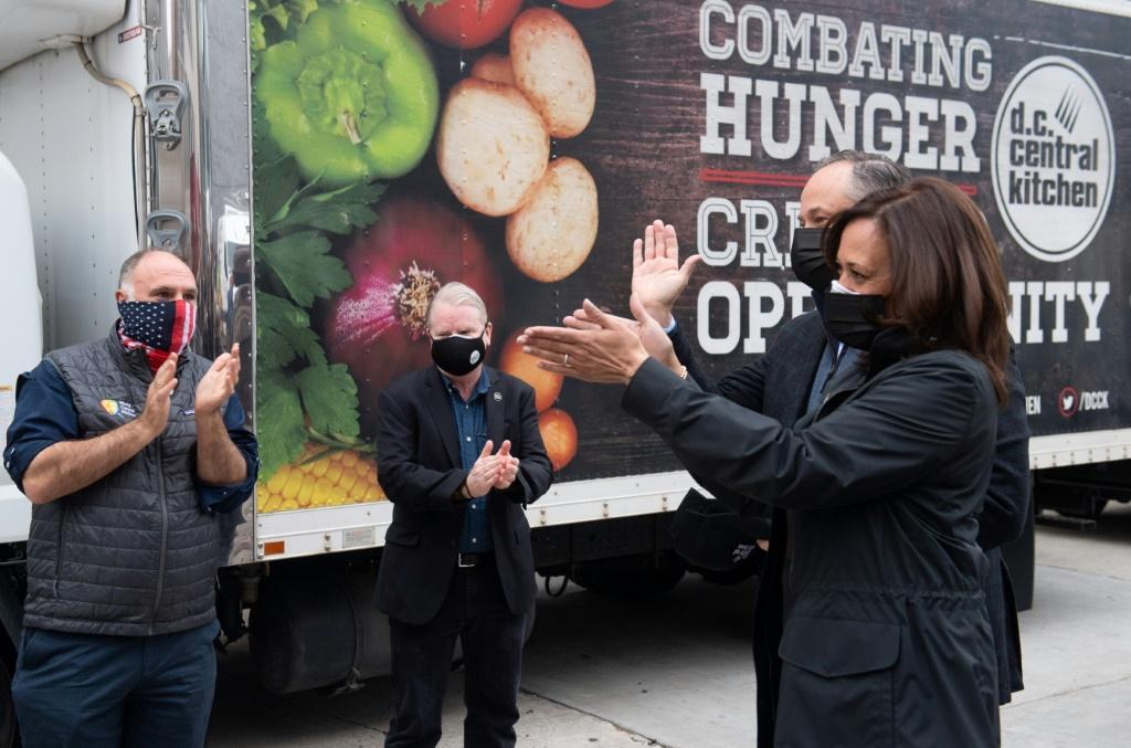 US Vice President-elect Kamala Harris and her husband Doug Emhoff visit a food bank in Washington, DC on November 25, 2020, ahead of the Thanksgiving holiday