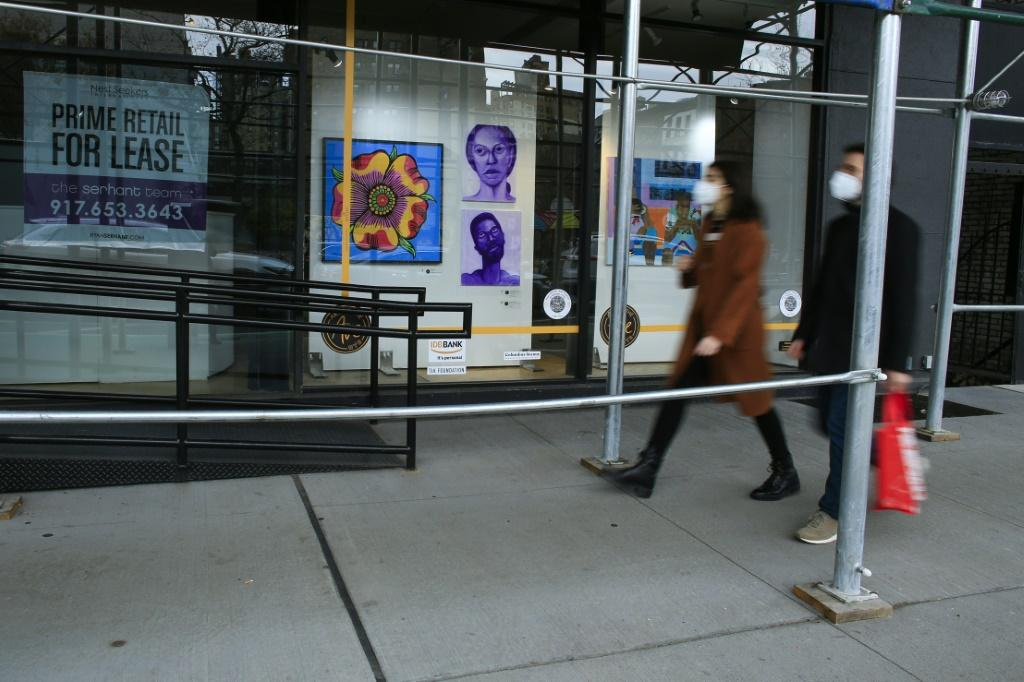 "Art is displayed in a ""For Lease"" retail space in the Art on the Ave exhibition in New York on November 28, 2020"