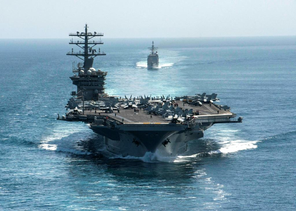 This US Navy handout photo shows the aircraft carrier USS Nimitz and the guided-missile cruiser USS Philippine Sea steaming through the Strait of Hormuz on September 18, 2020