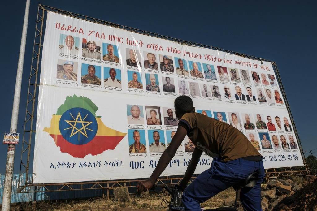 A sign lists members of the Tigray People's Liberation Front (TPLF) wanted by the Ethiopian Federal Police, as analysts warn the regional party could turn to insurgency-style warfare
